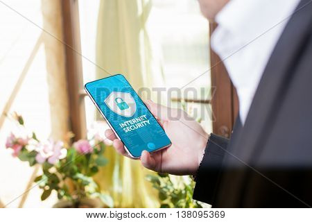Business technology internet and networking concept. Young businessman working on the phone in the office select the icon security on the virtual display