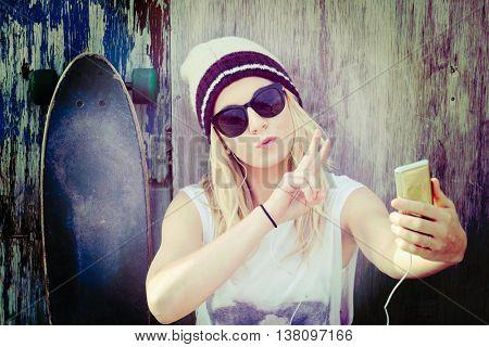 Pretty skater girl taking a selfie