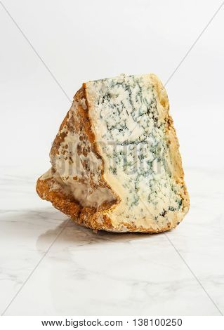 A piece of artisan blue cheese straight from the farm. Cabrales.