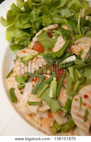 Thai cuisine spicy pork salad on dish or Yum Moo Yor.