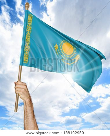 Person's hand holding the Kazakhstan national flag and waving it in the sky, 3D rendering