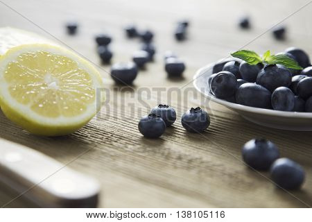 closeup portrait of blueberries on wood top