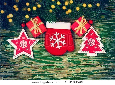Christmas background with spruce branches christmas baubles on old wooden green table