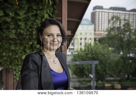 Portrait of a mature businesswoman in a blue evening dress.