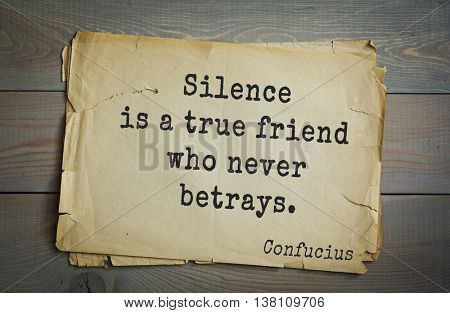 Ancient chinese philosopher Confucius quote on old paper background. Silence is a true friend who never betrays.