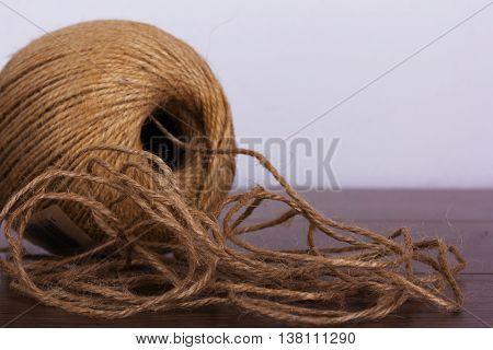 Ball Of String On A Wooden Background