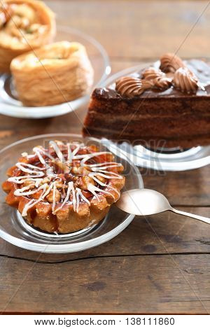 Set of various cakes on nice wooden background