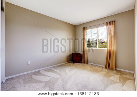 Bright Empty Room With One Window, Carpet Floor And Ivory Walls