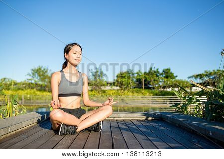 Woman doing yoga at outdoor