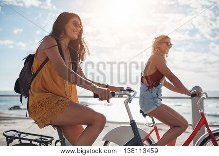 Female Cyclist Riding Along The Promenade