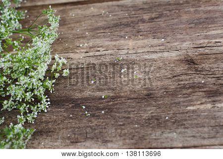 Wooden background with field summer flowers, void. Copyspace for commercials, rustic style