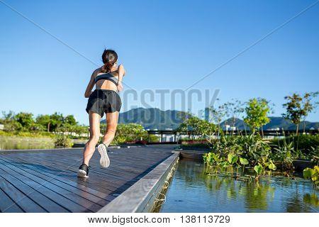 Woman running in outdoor park