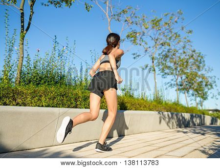 Woman running at morning