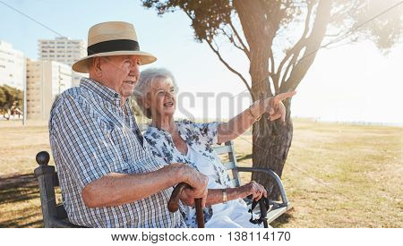 Retired Couple Relaxing On A Park Bench