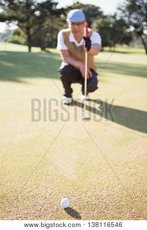 Blurred picture of sportsman analysing the field on a golf course
