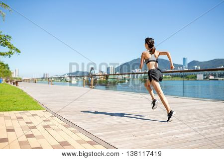 Young woman running at outdoor