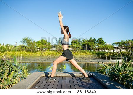 Women do stretching in park