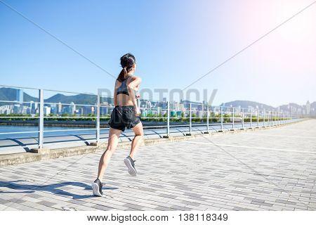 Woman running in city of Hong Kong