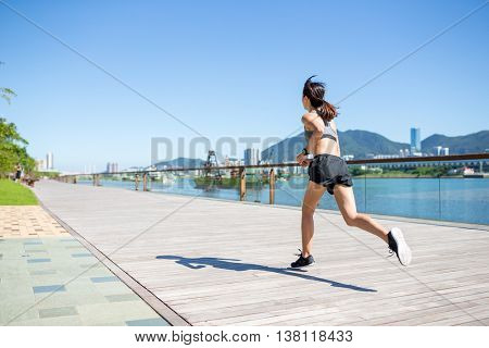 Woman running at the city