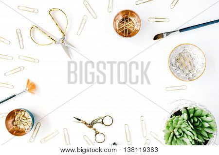 feminine desk workspace frame with succulent scissors and golden clips on white background. flat lay top view