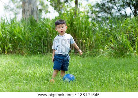 Asian little boy play soccer