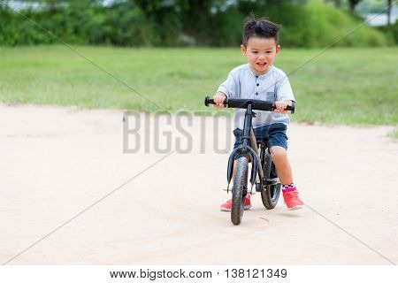 Little boy cycling at outdoor