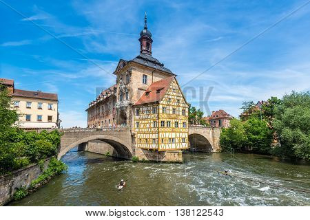 Bamberg Germany - May 22 2016: Tourists on a bridge near the City Hall half timbered end Altes Rathaus (former city hall) in Bamberg Upper Franconia Bavaria Germany.