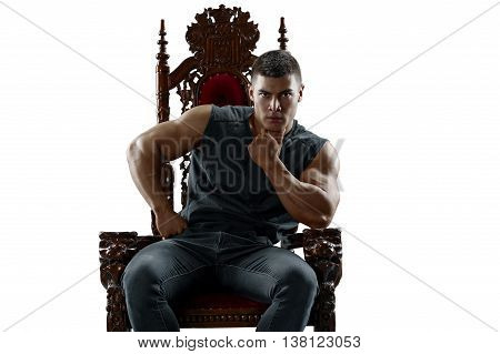 Ponderer muscular man on the throne. Isolated