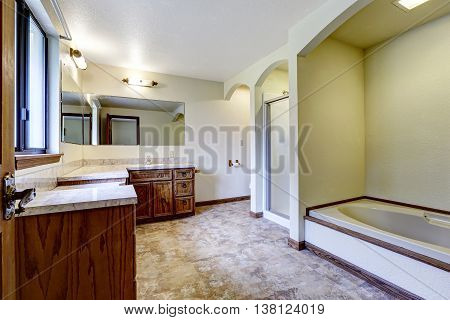 Luxury Bathroom Interior With Wooden Cabinets And White Bath Tub
