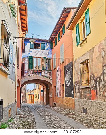 DOZZA, BOLOGNA, ITALY - FEBRUARY 28: street with paintings in ancient town where every two years takes place the festival of the painted wall and famous artists paint works on the walls of the houses. February 28, 2015 in Dozza, BO, Emilia Romagna, Italy