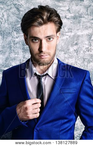 Handsome respectable middle-aged man in elegant suit. Men's beauty, fashion.