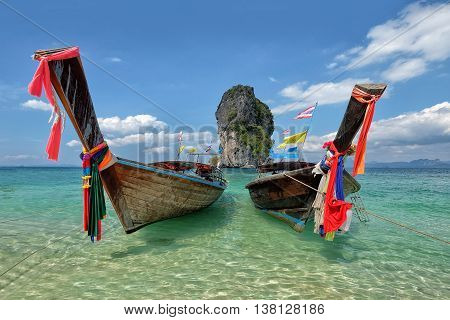 Fishing thai boats and landmark at Po-da island Krabi Province Andaman Sea South of Thailand.