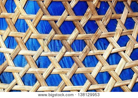 Wooden weave, basketwork twill weave, texture of bamboo background. Fabric blue background.