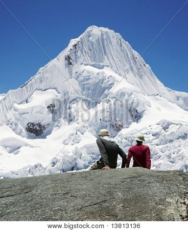 Girl and boy are looking to Alpamayo peak