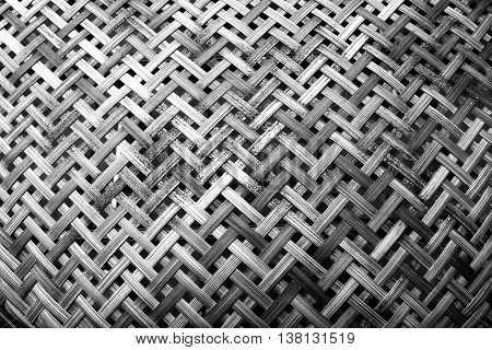 Wooden weave, basketwork twill weave, texture of bamboo wall background. Black and white tone.
