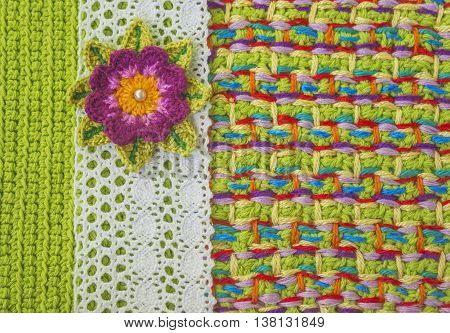 Handmade crochet pattern knitting sewing. Homemade stitch colorful backdrop embroidery with flower lace. Background for sketchbook notebook. Place for text