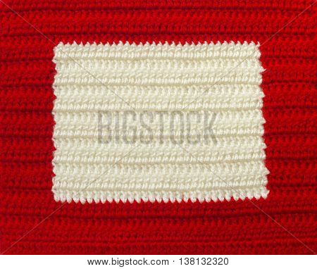 Handmade red and white crochet frame pattern knitting sewing. Homemade colorful backdrop. Background for sketchbook notebook Christmas yuletide Valentine's day. Place for text.
