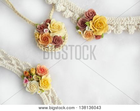 Beautiful handmade polymer clay rose necklace jewelry background