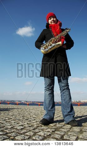 Beautiful girl with saxophone