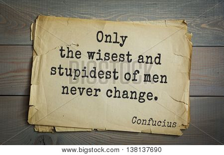 Ancient chinese philosopher Confucius quote on old paper background. Only the wisest and stupidest of men never change.