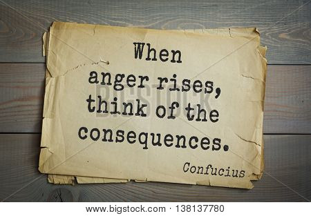Ancient chinese philosopher Confucius quote on old paper background. When anger rises, think of the consequences.