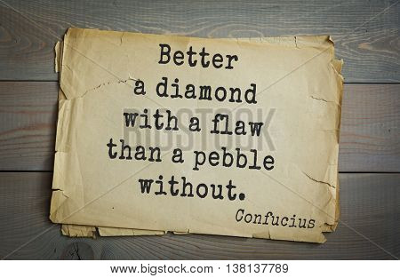 Ancient chinese philosopher Confucius quote on old paper background. Better a diamond with a flaw than a pebble without.