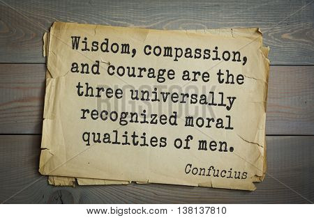 Ancient chinese philosopher Confucius quote on old paper background.  Wisdom, compassion, and courage are the three universally recognized moral qualities of men. poster