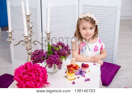 Little beautiful girl celebrate her fourth birthday