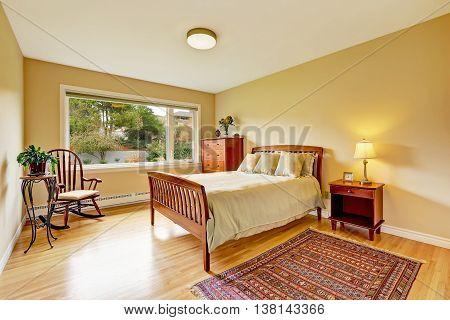 Bedroom With Hardwood Floor, Bright Walls