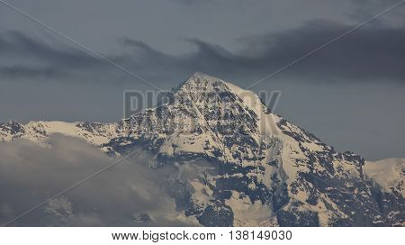Peak of Mt Monch and clouds. Scene in the Swiss Alps.