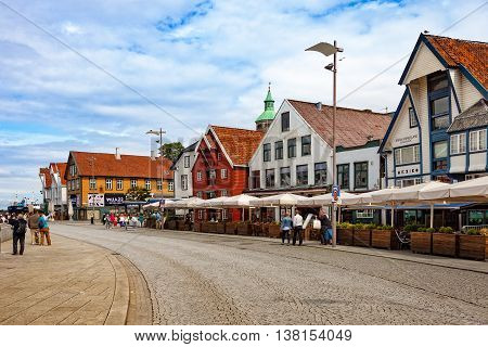 STAVANGER, NORWAY - JULY 13, 2015: Unidentified people shopping and sightseeing city center with many restaurants and pubs around. Stavanger is one of most famous cruise travel destinations in Europe.