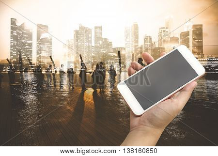 Hand Holding Smartphone With City People