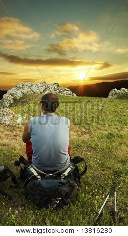 Man overview landscapes on sunset