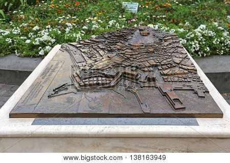 NAPLES ITALY - JUNE 25: Tocca Napoli Con Mano in Naples on JUNE 25 2014. 3d Relief City Map at Piazza dei Martiri in Naples Italy.